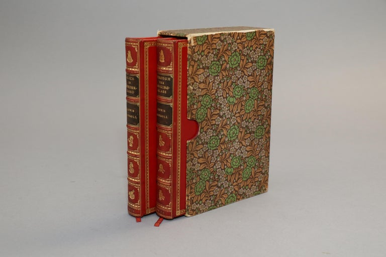 2 volumes. Early Editions! Bound in full red calf by Sangorski & Sutcliffe. Original covers bound in rear with all edges gilt, raised bands, and gilt panels. Set includes box cover. Front and rear covers feature gilt vignettes of The Queen, Alice,