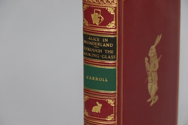 Leatherbound. One volume. Bound in full red calf by Bayntun Binders with all edges gilt, raised bands on spine, and gilt tooling on covers and spine. Illustrated by John Tenniel. Very good. Published in London by Macmillan at St. Martin's Press in