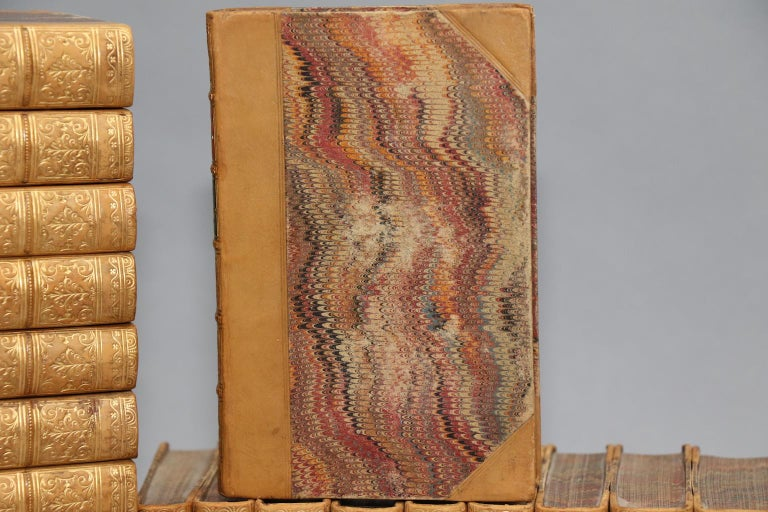 Rare first edition. Leather bound. 40 volumes. Small octavos. Contemporarily bound in three-quarter tan calf leather with marbled boards and edges and raised bands with gilt detailing on spines. Profusely illustrated with hand-colored plates
