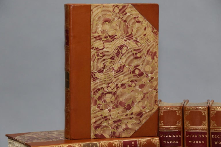 Leatherbound. Fifteen volumes. Bound in three quarter tan calf and marbled boards, top edges gilt, and gilt panels. Illustrated throughout. Very good. Published in Philadelphia & New York by Dicken's Society. Not dated, circa early 1900s.  All