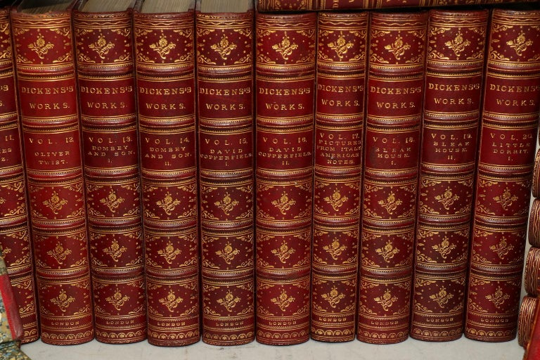 Library edition. Leatherbound. Thirty volumes. Octavo. Bound in three quarter red morocco, marbled boards, top edges gilt, raised bands, and with ornate gilt tooling on spines. Very good. Published in London by Chapman and Hall. Not dated, circa