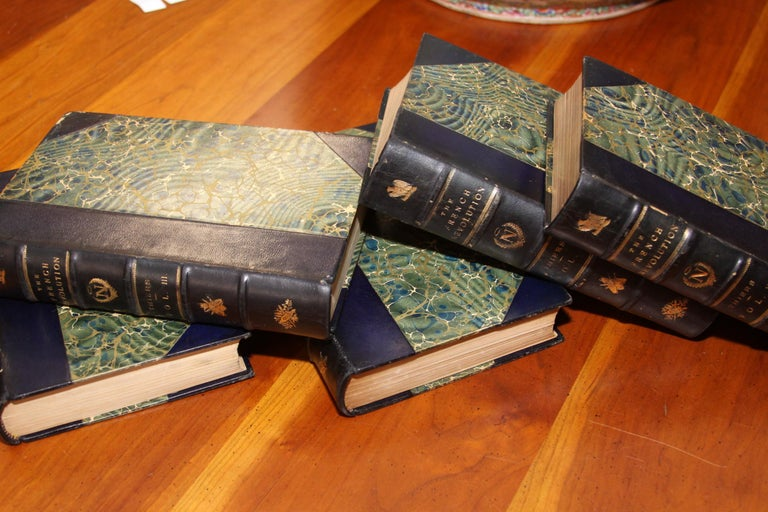 The History of the French Revolution, by Louis A. Theirs, Published: Philadelphia. 1894, J.B. Lippincott Company. Five volumes. Bound in three quarter blue morocco, spine gilt in gold decorations with gilt title, raised bands, top edge gilt, marbled