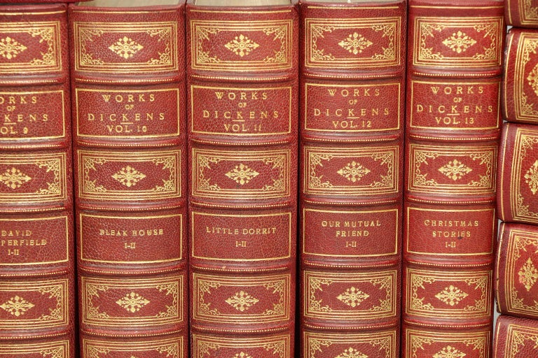George Cruikshank & Hablot K. Browne. National Library Edition. Leatherbound. 20 volumes. Bound in three quarter red morocco, top edges gilt, raised bands, and ornate gilt on spines. Profusely illustrated throughout by George Cruikshank and Hablot