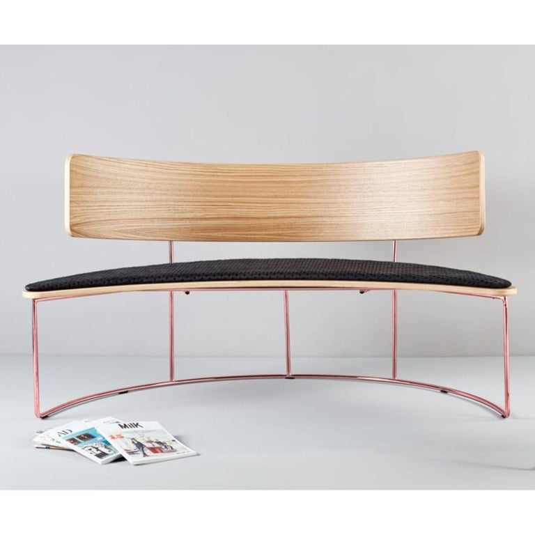 Boomerang bench - black by Cardeoli  Dimensions: W 152, D 72, H 79, seat 43 Materials: Paint coated iron structure / gold / copper or chromed iron structure Plywood backrest and seat covered with a natural oak wood layer Upholstered seat
