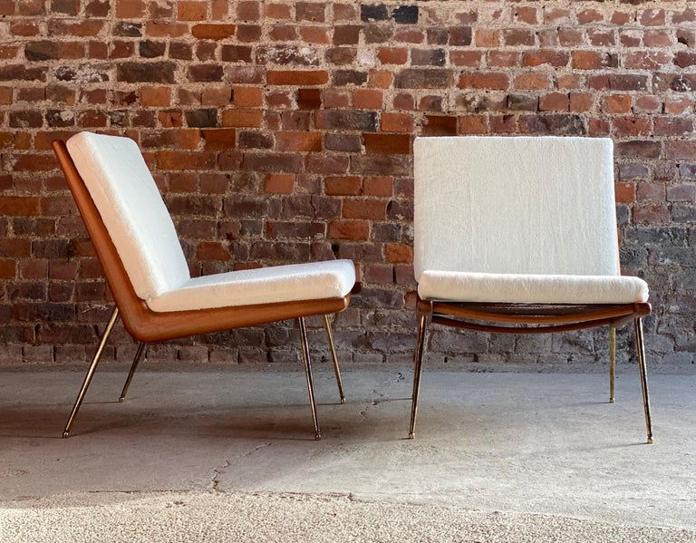 Boomerang chairs France & Son Pair of Peter Hvidt & Orla Mølgaard Nielsen, 1950s  A pair of Boomerang chairs by Peter Hvidt and Orla Mølgaard Nielsen manufactured by France & Son, Denmark, the teak frames sit on brass-plated legs with sabots, The