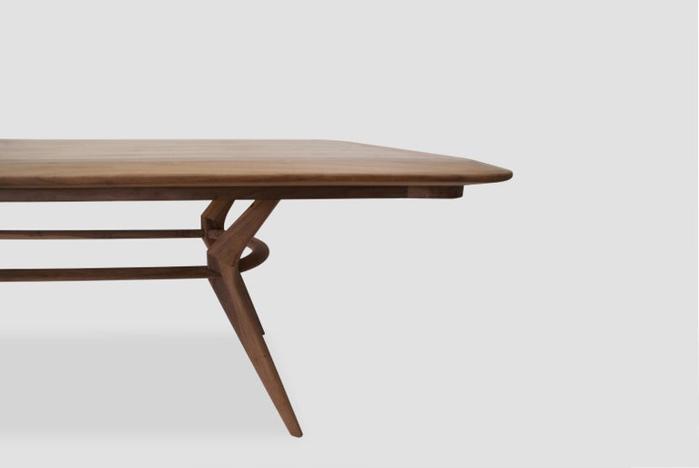 Boomerang rectangular table is a walnut rectangular dining table designed by Arturo Verástegui for Breuer Estudio. This piece is part of Diseño y Ebanistería, Breuer Estudio first ever collection, in which they collaborated with top designers to