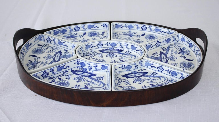 A seven piece hors d'oeuvres dishes and tray from the renowned English pottery company Booths in their