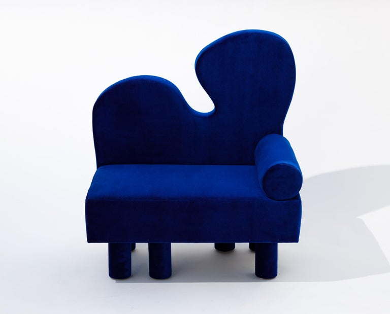 With Bordon, an oversized chair upholstered in a vibrant blue velvet, another human explores fantastical shapes reminiscent of Matisse while creating a dreamlike creature, complete with six chunky legs offset in their placement, creating the feeling