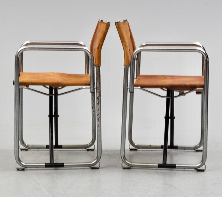 Early set of two folding chairs in chromed steel and original vegetal tanned leather, designed by Borge Lindau & Bo Lindekrantz and produced from the 1960s by Swedish Lammhults.