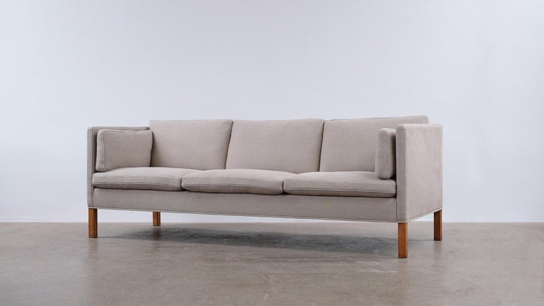 Wonderful classic 3-seat sofa, model 2443, designed byBørge Mogensen for Fredercia, Denmark. This example fully refurbished and reupholstered in beautiful heavy linen fabric by Kirkby Design. Ultra high quality and super comfortable with all down