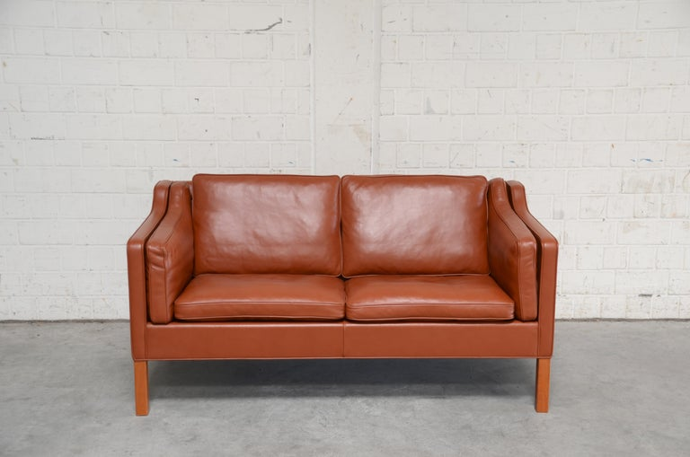 Borge Mogensen designed this leather sofa model 2212 for Fredericia Stolefabrik. It´s a semianilne red brandy cognac leather with teak feet. A Danish masterpiece of upholstery design and great seating comfort.