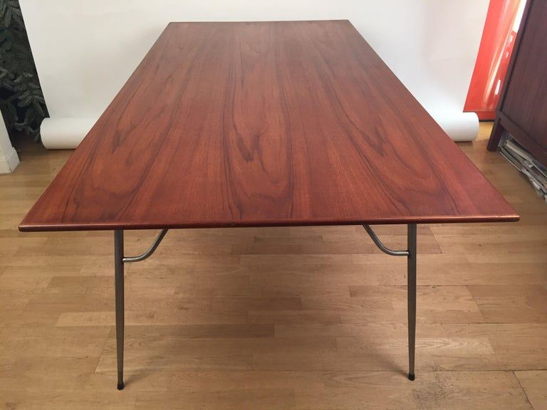 A dining/work table designed in 1954 by Borge Mogensen and manufactured by Soborg Mobler in 1956. Teak plate and foldable steel base. Excellent condition. Fully original.