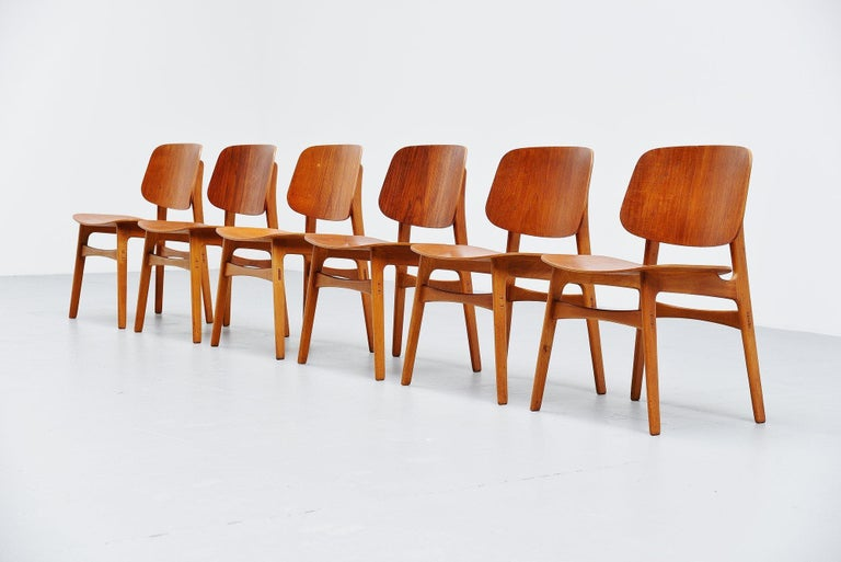Fantastic set of 6 plywood dining chairs designed by Borge Mogensen and manufactured by Soborg Mobelfabrik, Denmark 1949. These amazing chairs are made of teak plywood seats and backs and have beech wood frames. These chairs are beautifully