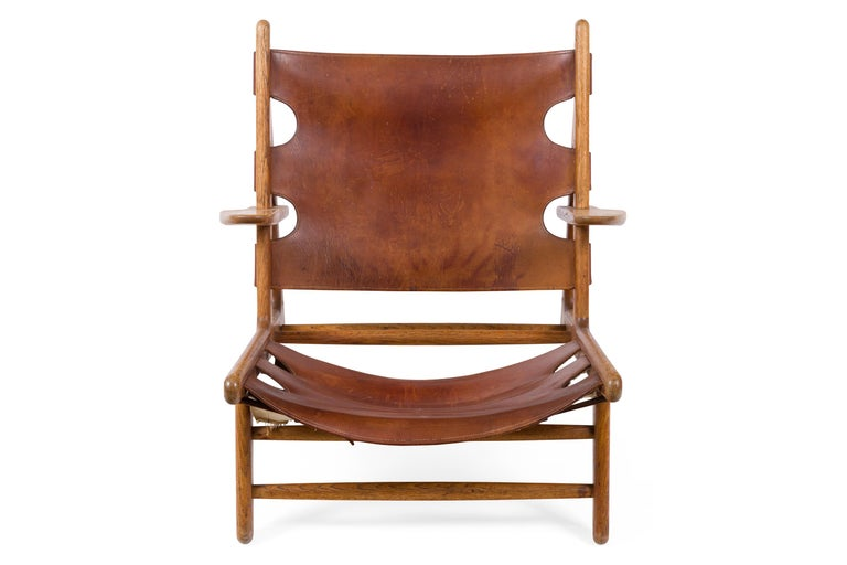 The Hunting Chair, Mogensen's low lounge chair with solid, patinated oak frame. The seat and back are the original patinated natural leather.