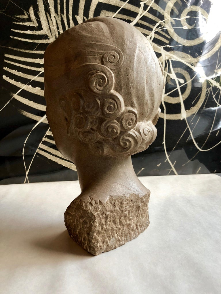 This is a portrait sculpture bust of a flapper woman. The sitter was Frances Widney, (Mrs. Robert Gump of the San Francisco family who owned Gump's Department stores). This auction is for the sculpture and th accompanying items. It came accompanied