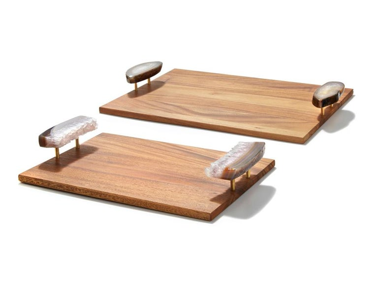 Pairing solid acacia wood with brass and natural stone (rare druze and polished agate), these trays (named after the Portuguese word for wood) are authentic and substantial. Like many of the signature designs from Anna, the natural edges of the