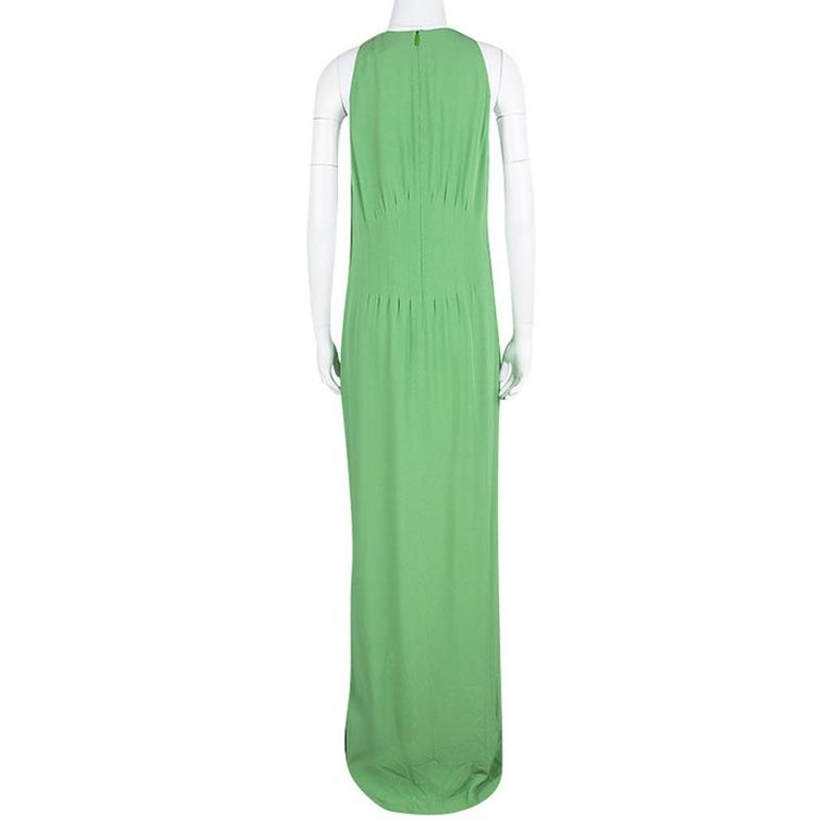 The house of Hugo Boss bring to a chic silhouette to make a timeless fashion statement. This V-Neck maxi dress is elegantly crafted with an inverted pin-tuck design at the waist to add more shape to the ensemble and give you a stylishly