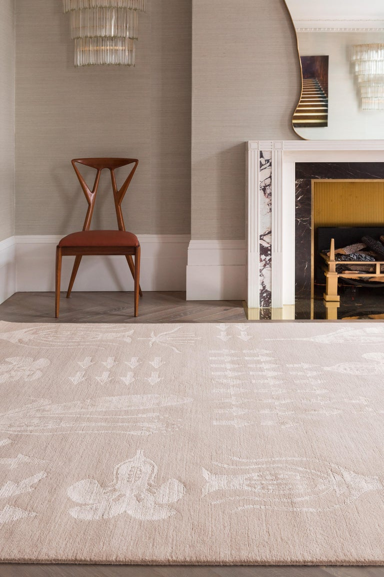 Inspired by Kane's botanical fashion collection, this rug subverts and amplifies the traditional floral motif, which recurs throughout to create a highly decorative statement design. Hand-knotted from a combination of rich silk yarns and Tibetan