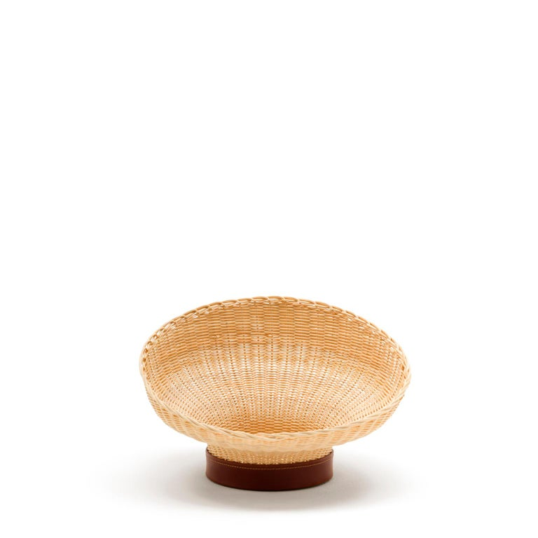 """Mawa  """"A centerpiece draw its inspiration from Nature. Mawa, narrow at the base and wider towards the top, borrows its features from a flower in all its splendor.""""  This container reinterprets the archetype of the woven basket in a contemporary"""