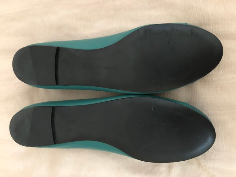 Lovely green ballerina flats with a darker green toe cap; zig zag trim; tassels and a wonderful intrecciato weave cushioned insert. We also have an Irish green intrecciato weave handbag for sale on this site (as shown in the picture), for $495. The