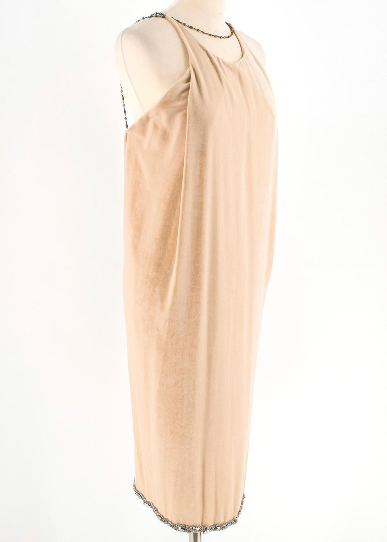 Bottega Veneta Beige Velvet Chain Draped Low Back Embellished Dress  Soft velvet, sleeveless, high neck dress  Weighted crystal gem embellishment on hem of dress Chain Neck & Back detailing Low open back with chain detailing across the back  Lobster