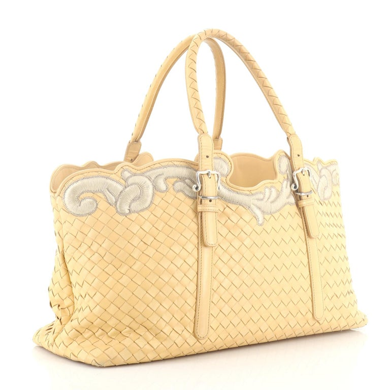 This Bottega Veneta Belted Cabat Tote Embroidered Intrecciato Nappa, crafted in neutral leather woven in Bottega Veneta's signature intrecciato method, features adjustable dual-rolled woven handles, elegantly embroidered details and aged silver-tone