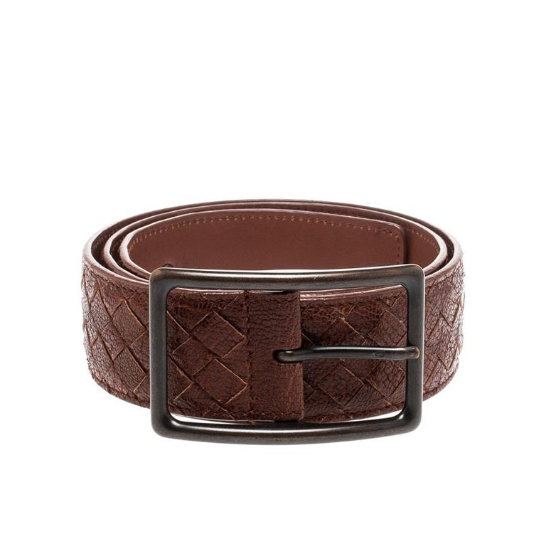 Give your outfit a stylish touch with this Bottega Veneta belt. Made from Intrecciato woven leather, its brown color is contrasted with black-tone eyelets and buckle.  Includes: Original Dustbag