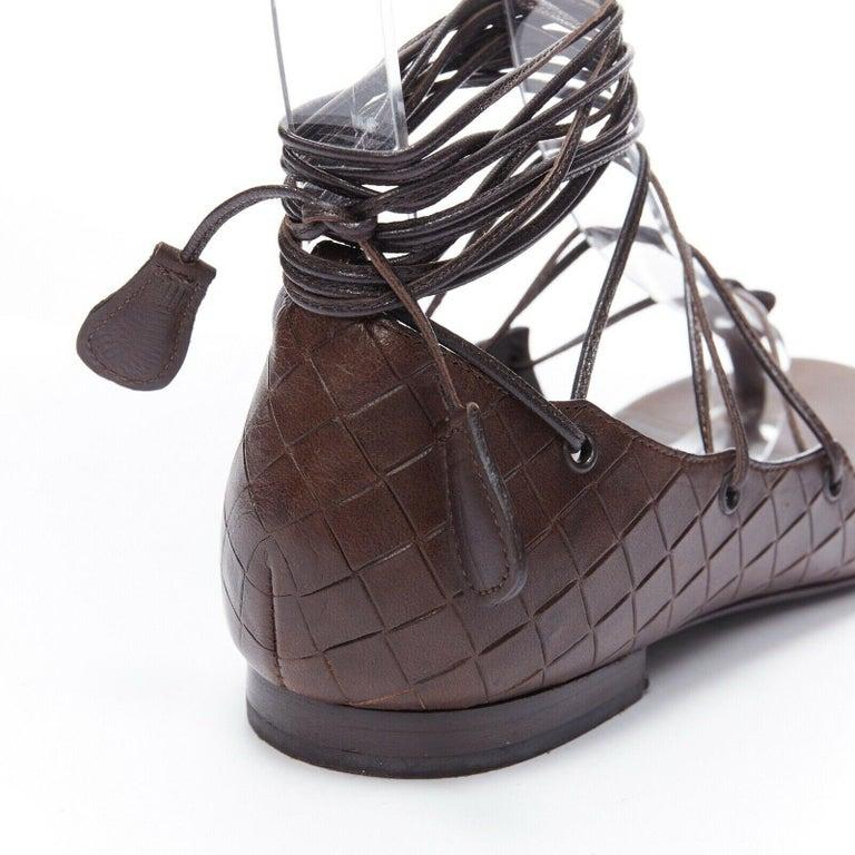 BOTTEGA VENETA brown intrecciato woven leather lace up thong flat sandals EU37  BOTTEGA VENETA Brown lace up flat sandals. Covered heel. Intrecciato embossed leather at back. Gunmetal grommet. Lace up front. Thong sandals. Leather footbed. Stacked
