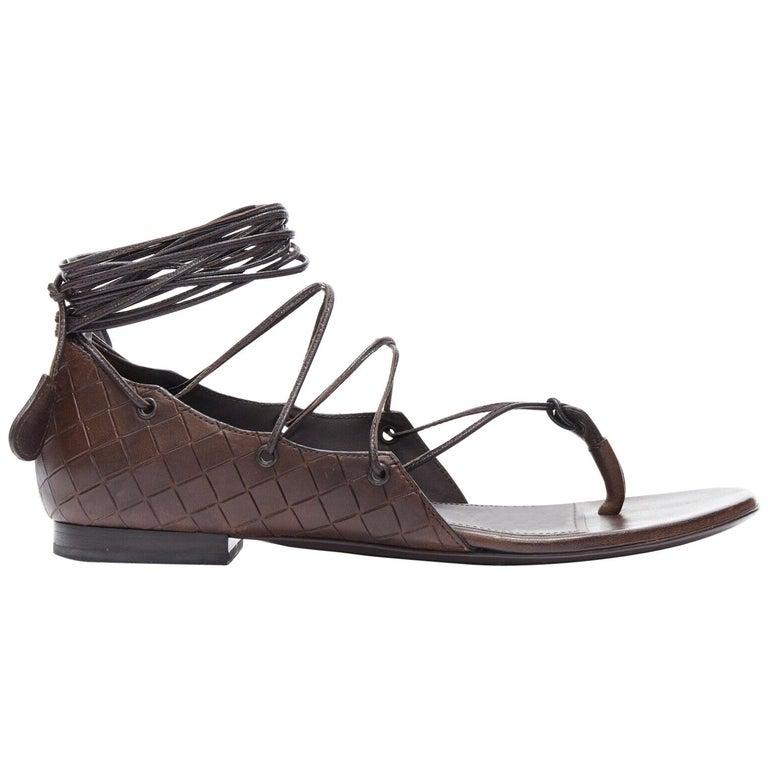 BOTTEGA VENETA brown intrecciato woven leather lace up thong flat sandals EU37 For Sale