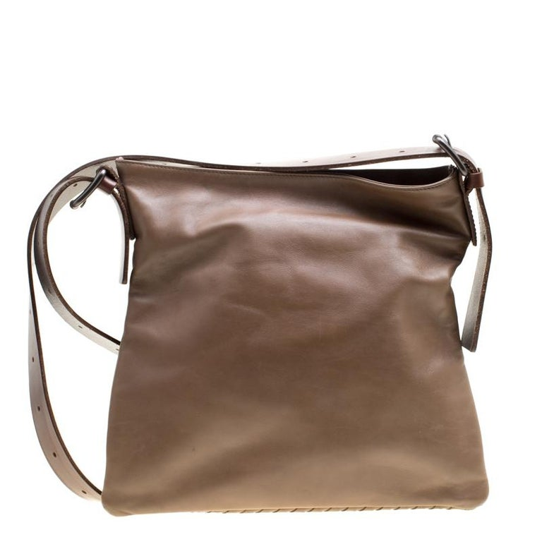 This messenger bag from Bottega Veneta comes loaded with excellent style and craftsmanship. The bag has been crafted from leather and designed with shoulder strap and a fabric interior sized to carry your belongings.  Includes: Original Dustbag  The