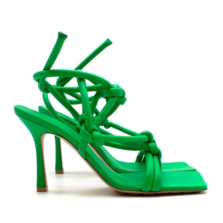 Bottega Veneta Dream Knotted Leather Sandals in Green    Set on a squared footbed and slender 100mm stiletto heels, they secure with knotted leather straps that are rolled at the edges for a comfortable fit. Wear yours with everything from cropped