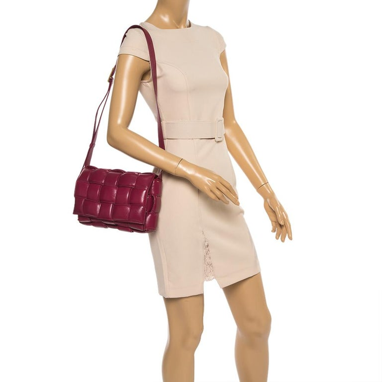 The current bag on many fashionista's minds is this Cassette bag from the house of Bottega Veneta. We have here the one in magenta leather, flaunting a padded maxi weave and a shoulder strap. The insides are sized to fit your phone and other little