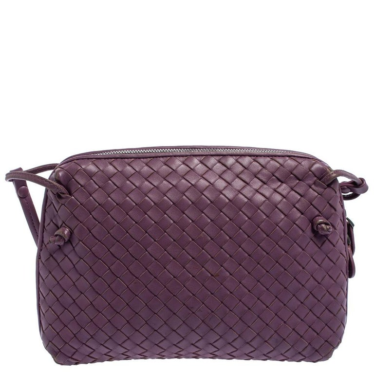This Nodini bag from Bottega Veneta is crafted from purple leather using their signature Intrecciato weaving technique flaunting a seamless silhouette. Brimming with artistry and quality craftsmanship, the bag has an interior that is spacious enough