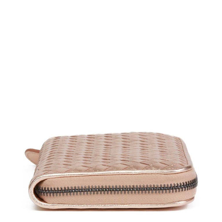 BOTTEGA VENETA Rose Gold Woven Metallic Grosgrain Calfskin Leather Zip Around Wallet  Reference: HB2074 Serial Number: B05845043V Age (Circa): 2010 Accompanied By: Bottega Veneta Dust Bag, Box, Tags, Care Booklet Authenticity Details: Authenticity