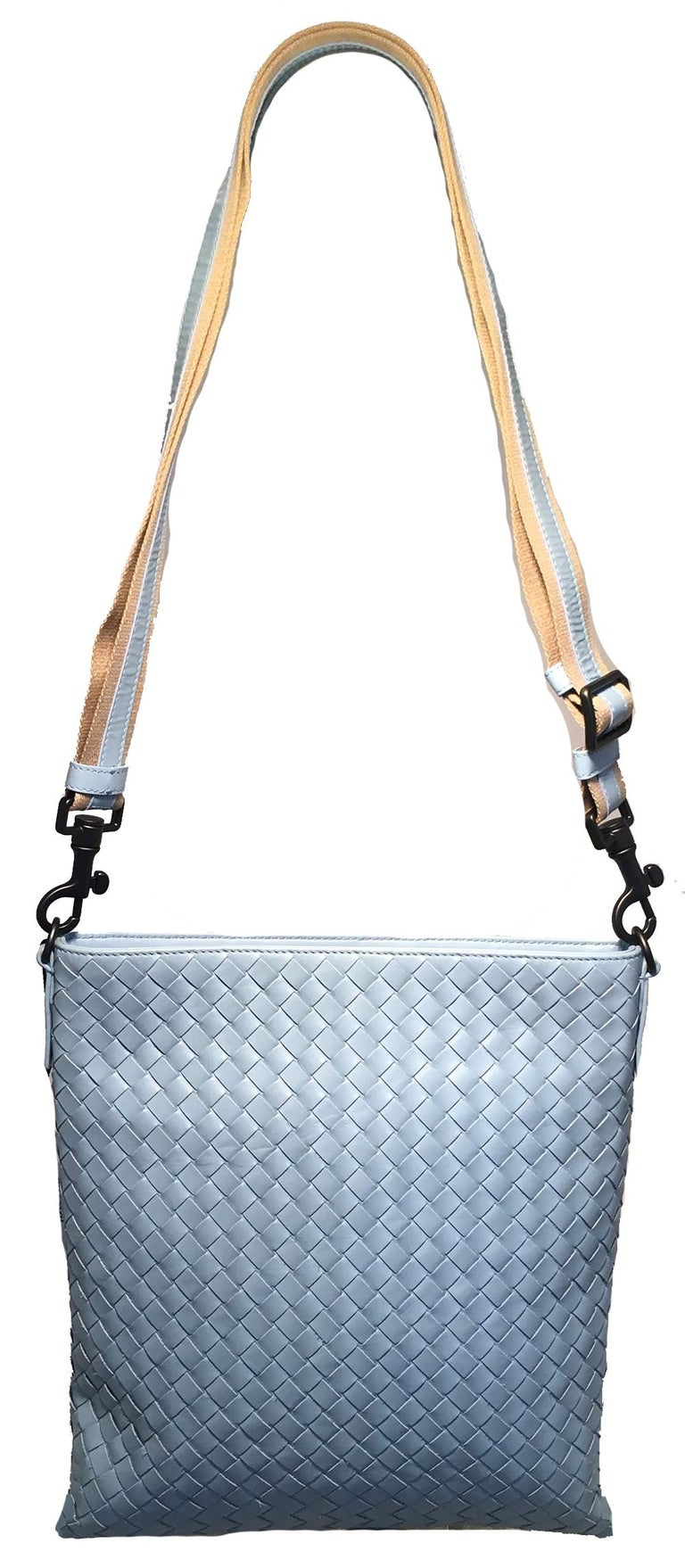 Bottega Veneta Woven Baby Blue Leather Convertible Messenger Shoulder Bag in excellent condition. Woven baby sky blue leather trimmed with a striped tan canvas and blue leather adjustable and removable shoulder strap and gunmetal hardware. Top