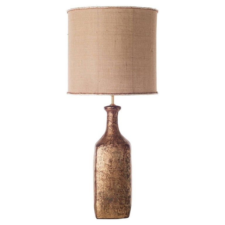 Bottle ceramic table lamps with shades.