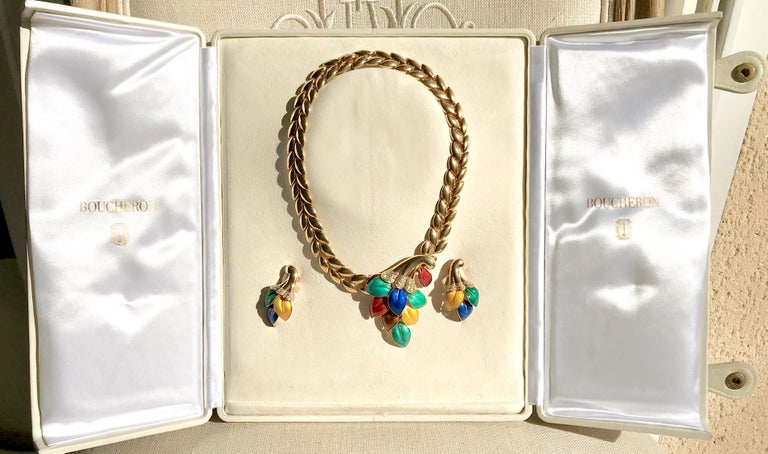 Boucheron Set composed of a Necklace and a Pair of Earrings in 18 Carat Yellow Gold Enamelled of Various Colors and Diamonds. Pattern of Horns of Plenty holding Polychrome Enamelled Leaves. The Ear clips set with 20 Diamonds each, for a Weight of