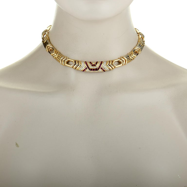 "This Boucheron necklace is made of 18K yellow gold, and set with diamonds and rubies. The rubies weigh 2.25 carats and the diamonds total 1.65 carats, boasting grade F color and VVS clarity. The necklace has a chain length of 15"", weighs a total of"