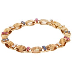 Boucheron 18 Karat Yellow Gold Diamond, Sapphire and Ruby Bracelet