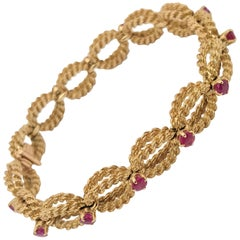 Boucheron 18 Karat Yellow Gold Woven Rope and Ruby Bracelet