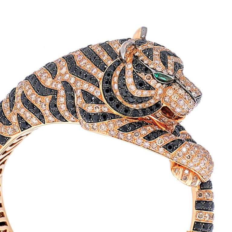 Fine jewelry fans already know that Boucheron likes to work with some unusual animal motifs, to produce majestic gemstone-encrusted swans, beguiling snakes, and sparkling chameleons. Now Boucheron created this ferocious Bengal tiger with a pink gold