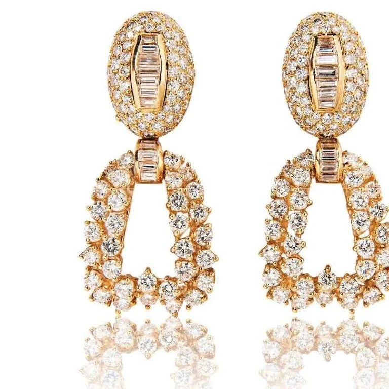 Bursting with late-70s glamour, Boucheron's day and night diamond earrings are the essence of versatility for today's busy world. An elegant oval bombe form is set with round and baguette diamonds and suspends a detachable pendant further set with
