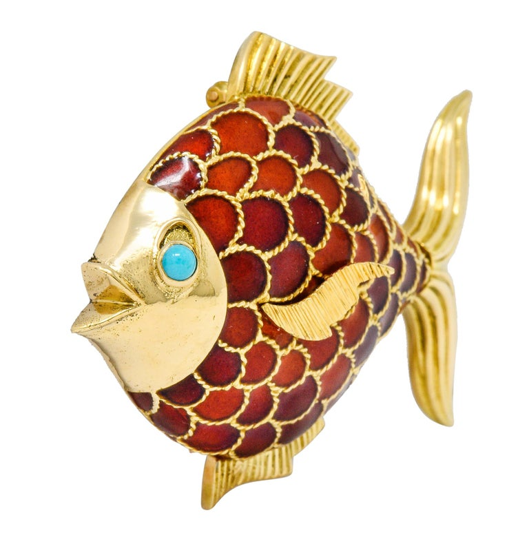 Brooch is designed as an adorable fish with twisted rope motif scales and deeply ribbed fins  Scales are glossed with boldly red to orangey-red enamel with no loss  Accented by a bright greenish-blue 2.8 mm turquoise cabochon eye  Completed by a