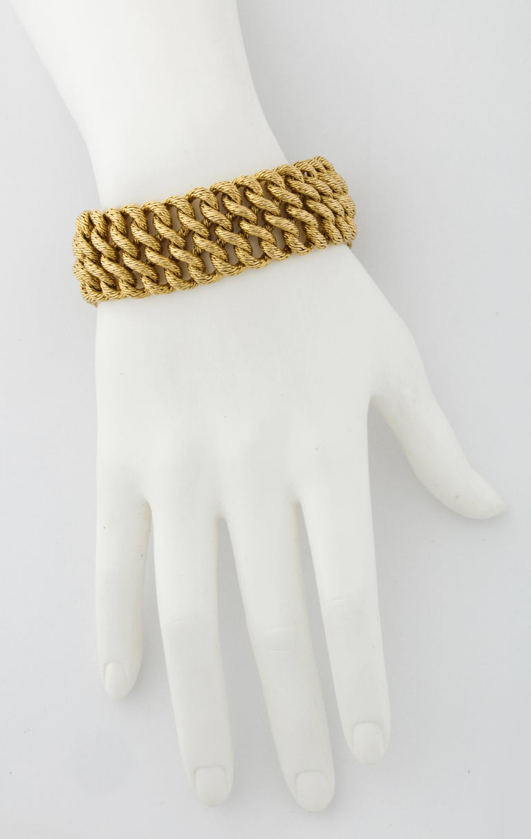 The intricate gold work is what gives this bracelet such a wonderful texture.  Bold, yet comfortable, Boucheron's designs of the 1960s are as iconic today as they were then.  True style and fashion from one of France's most infamous jewelers and