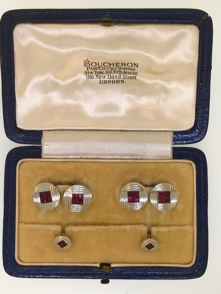 Beautiful Boucheron of Paris Platinum Ruby Cufflink and Collar Pin Set. Circa 1930.  Pure Art Deco style!  With original Box!  1 Carat of good quality French cut Rubies.  Classic Double sided cufflinks.  From an estate in London.  Vintage Art Deco