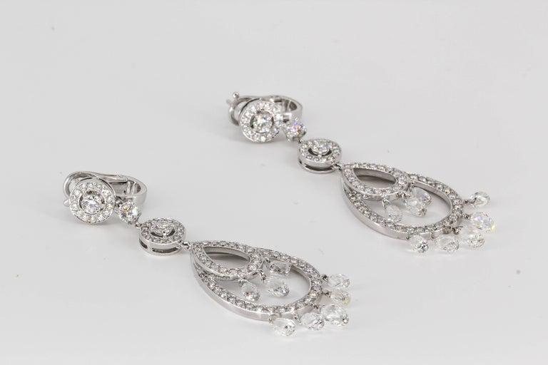 Elegant diamond and 18K white gold pendant earrings from the