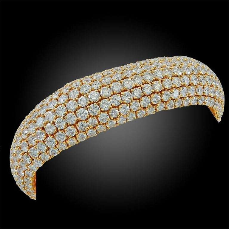 18k yellow gold flexible Bombe bracelet, composed of seven rows of diamonds weighing approx. 65 cts., signed Boucheron.  circa-1980'S length - 6 3/4 inches FRENCH assay marks