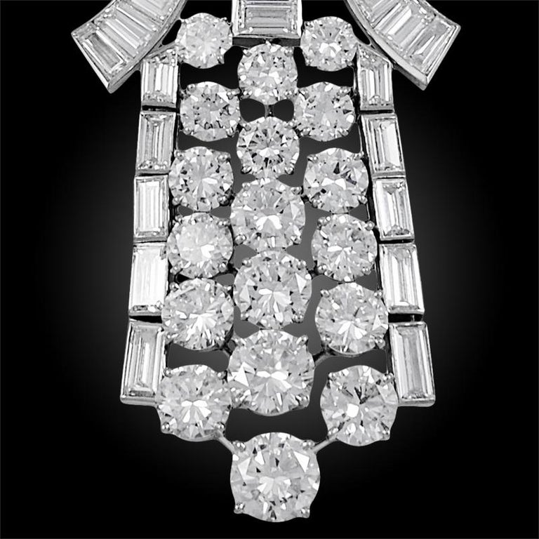 A truly magnificent 1960's Boucheron diamond necklace. Designed as a stylised, flexible ribbon set with graduated and tapered baguette & step-cut diamonds, suspending an articulated cascade of graduated brilliant-cut and baguette diamonds. The