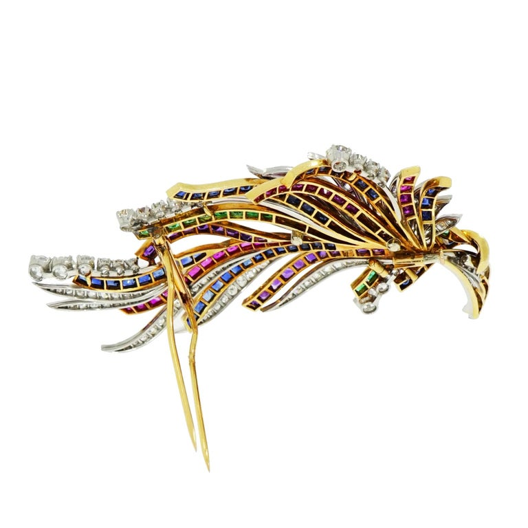 This Gorgeous ribbons and feathers like design vintage brooch... Handcrafted by Boucheron (Paris) in 18k Yellow and White Gold. Decorated with princess cut sapphires, rubies, emeralds and amethyst mixed in with white round diamonds displaying lively