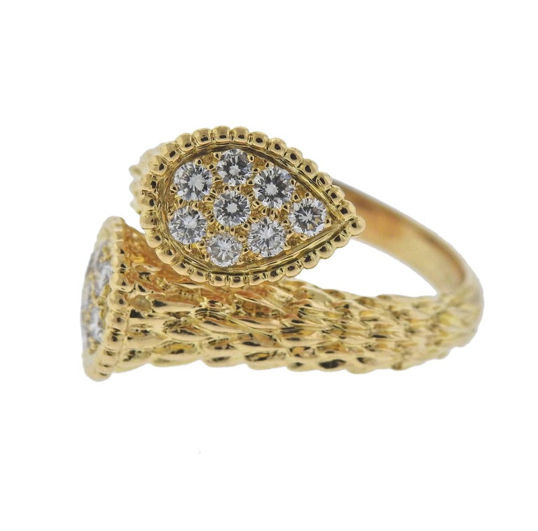 8229e1f8db13f3 Classic 18k yellow gold bypass rings from Serpent Boheme Toi et Moi  collection, decorated with